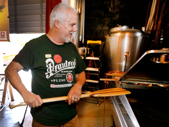 Joe MInter brews a batch of British Bitter at the Green Dragon Pub and Brewery, on Tuesday, Oct. 10, 2017.