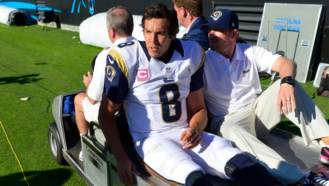 Bradford is carted off the field after suffering an injury in Sunday's loss.