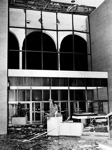 Shattered glass lies strewn in the entrance lobby to the 100 Oaks shopping mall after a tornado stuck nearby, blowing out the glass front of the structure April 1, 1974.