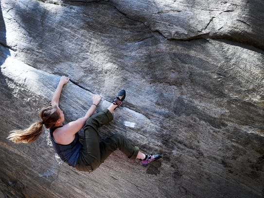 """Carly Lovas, of Charleston, climbs """"Dime Crack"""" during"""