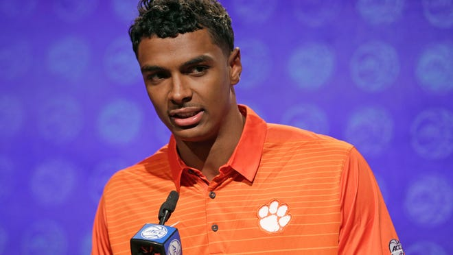 Clemson's Donte Grantham answers a question during the Atlantic Coast Conference men's NCAA college basketball media day in Charlotte, N.C., Wednesday, Oct. 25, 2017. (AP Photo/Chuck Burton)