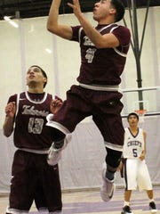 Tularosa's Cameron Sheppard puts up a shot Tuesday night.