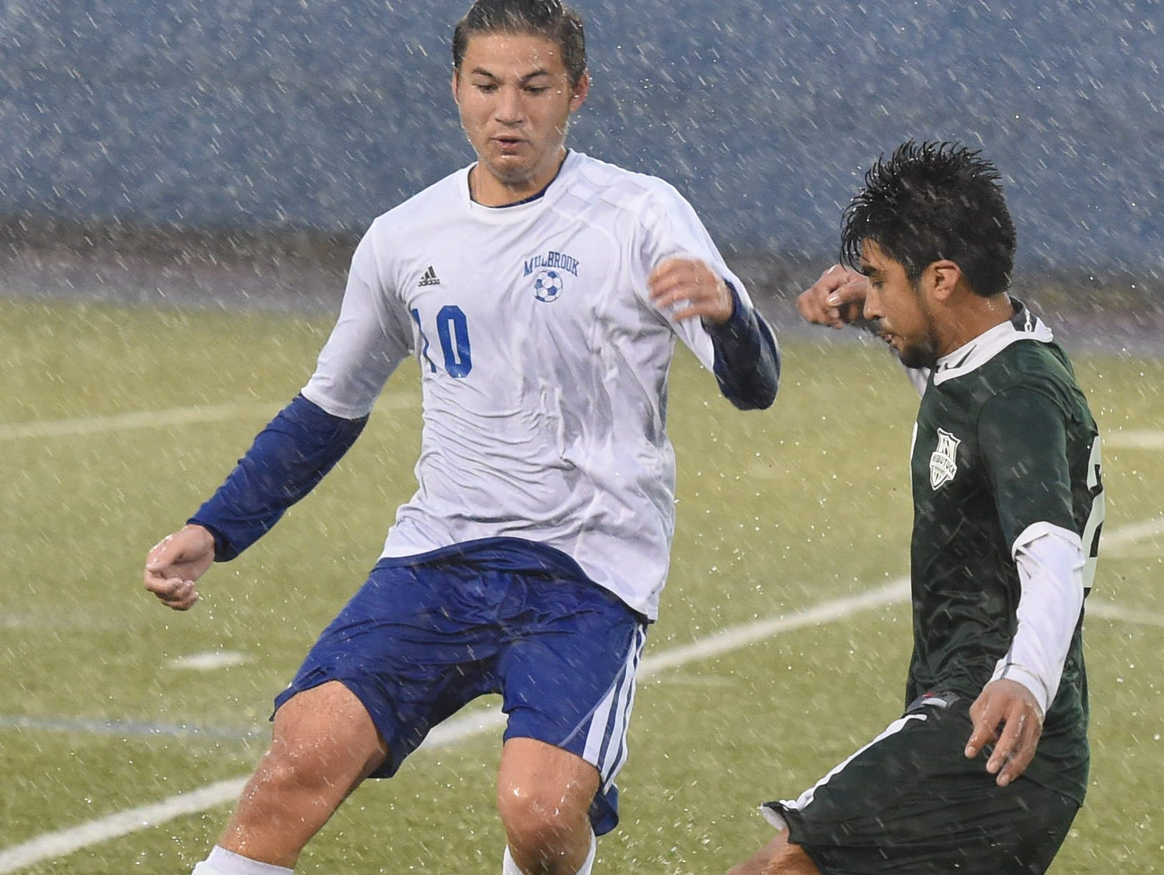 Webutuck's Fabian Vega keeps the ball away from Millbrook's Alfredo Sosa during the Section 9 Class C boys soccer championship on Wednesday.
