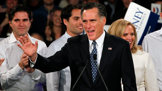 ORG XMIT: NHDA102 Former Massachusetts Gov. Mitt Romney waves to supporters at the Romney for President New Hampshire primary night rally at Southern New Hampshire University in Manchester, N.H., Tuesday, Jan. 10, 2012. Behind Romney are his sons Tagg and Craig and his wife Ann. (AP Photo/Elise Amendola)