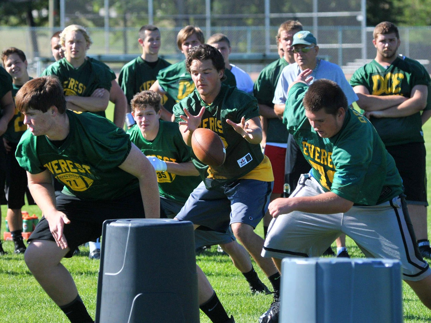 Members of the D.C. Everest football team go through a drill during practice earlier this week. The Evergreens are coming off a 3-6 season.