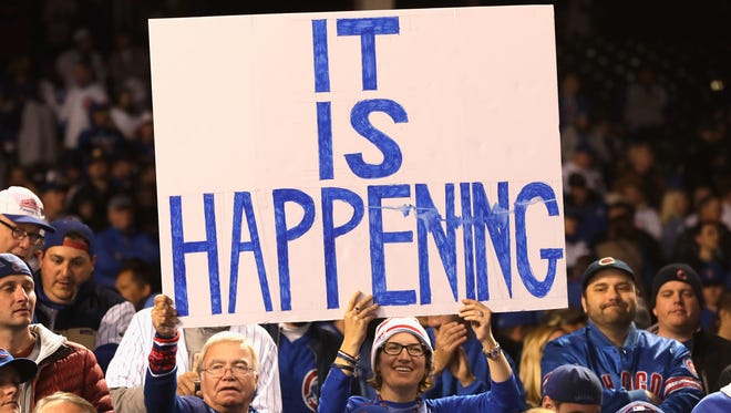 Chicago Cubs fans hold a sign after the Chicago Cubs defeated the Los Angeles Dodgers 5-0 in game six of the National League Championship Series to advance to the World Series against the Cleveland Indians at Wrigley Field on October 22, 2016 in Chicago, Illinois.