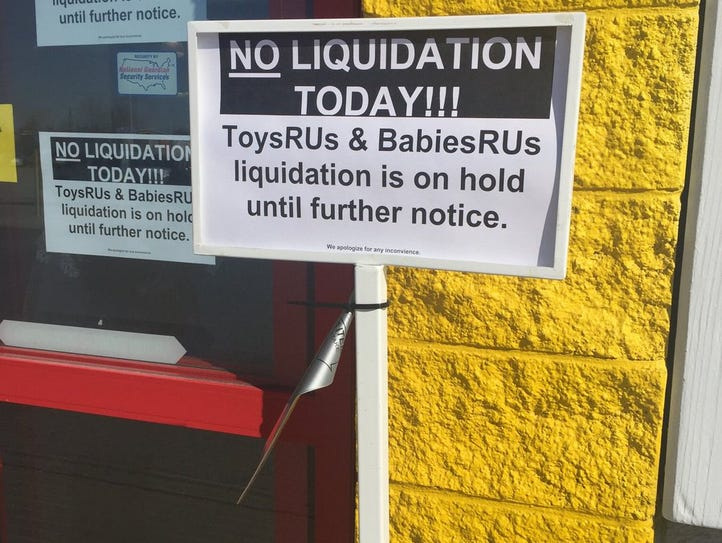 Signs outside the Toys R Us store in Evansville, Ind.,