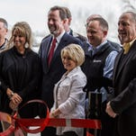 Front Range Community College President, Andy Dorsey, center, poses for a picture with members of the Markley family of Markley Motors at the opening of Little Bear Peak at Front Range Community College on Feb. 27, 2015.