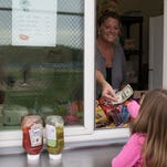 Kelly Dishaw volunteers at Harper Creek's varsity baseball concession stand during a game on Thursday.