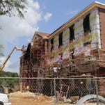 Construction crews brick the outside of Futral Hall, the newest residence hall at William Carey University.