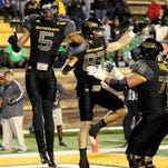 Casey Martin and teammates celebrate his touchdwon run Saturday night against North Texas in Hattiesburg, Mississippi on October 3, 2015.