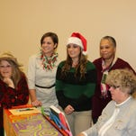 """""""Honky Tonk Angels Holiday Spectacular"""" cast members are, from left, Shereen LaPoint (Angela), Kerry Miller (Sue Ellen), Liz Costanzo (Darlene) and Charla Kibbler (Charilee). At the piano is Cheri Ayers, the show's musical director and pianoaccompanist."""
