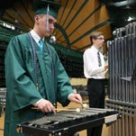Andrew Soulier plays the bells before the start of Fossil Ridge High School's commencement ceremony on Saturday, May 21, 2016 at Moby Arena in Fort Collins.