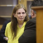 Donna Kay Scrivo, waits for her arraignment at 40th District Court in St. Clair Shores, Mich., on Monday, Feb. 3, 2014.