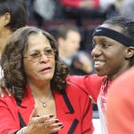 Rutgers senior point guard Syessence Davis puts her arm around coach C. Vivian Stringer after a win on Senior Day. Rutgers vs Indiana Womens Basketball at the RAC Sunday March 1, 2015 photo by Ed Pagliarini