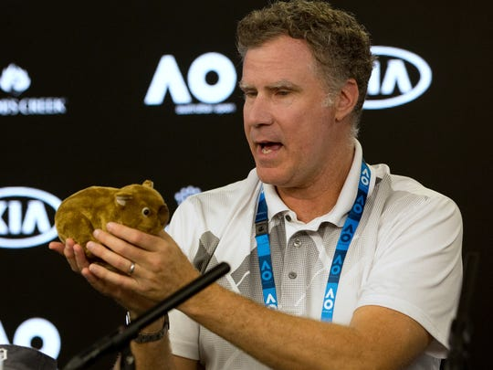 U.S. actor Will Ferrell holds up a toy wombat during a press conference at the Australian Open tennis championships in Melbourne, Thursday, Jan. 18, 2018.