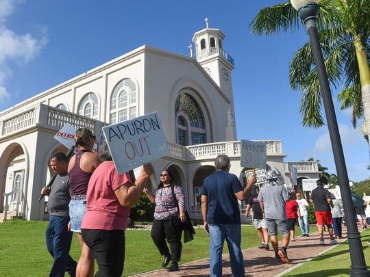 Members and supporters of the Laity Forward Movement and the Concerned Catholics of Guam protest against Archbishop Anthony Apuron in front of the Dulce Nombre de Maria Cathedral-Basilica in Hagatna on Jan. 29, 2017.