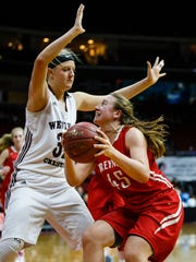 Treynor's Madelyn Deitchler (45) looks for a shot against