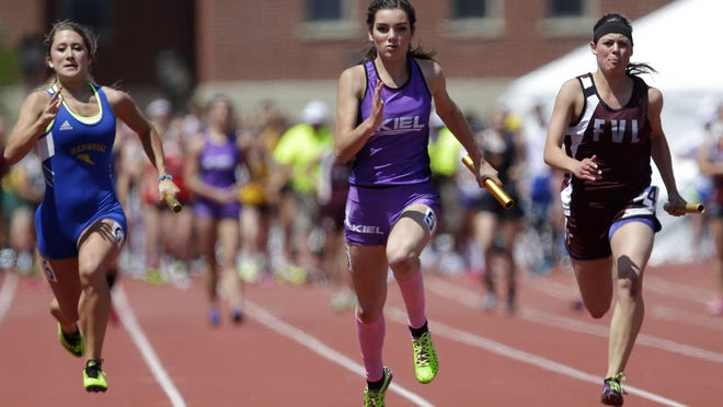 Kayla Lallensack of Kiel (center) runs down the final stretch of the WIAA Division 2 400-meter relay on Saturday. The Raiders won the event.