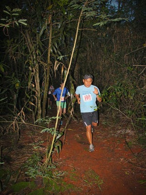 Runners make their way through the off-road trails during XTERRA Island's first trail run of the year at Two Lovers Point. XTERRA Island will debut a new trail run course at Tarzan Falls on Aug. 30.