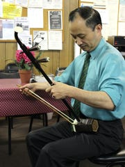 Dr. Ming Wang plays the Chinese violin, or er-hu.