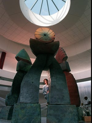 "Nancy Jurs after the installation of her ""Triad"" in 1995."