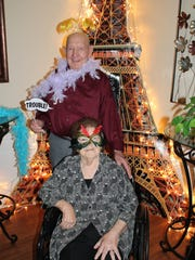 Some elders took advantage of the props in their photos by the Eiffel Tower.