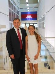 Madeline de Quillacq with U.S. Ambassador William Heidt