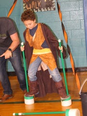 Eight-year-old Van Haigwood tested his balance by walking on padded sticks during the Frankenstein Walk and making it to the finish line.