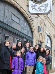 Barbara O'Neill has a tradition of taking her grandchildren to Watts Tea Shop for a Christmas lunch as each child reaches the age of 10. Everyone poses as they arrive at the restaurant Wednesday for the final time. Front row, from left, are Daphne, Megan, Emily, Genevieve and Rosemary. Back row from left are Sylvie, Barbara, Claire, Michael, Mary, Audrey and Grace.