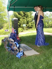 Sierra Bradway and her prom date, Brock Spayd, visit her father's grave before prom. IMPD Officer Rod Bradway was killed in the line of duty in 2013.