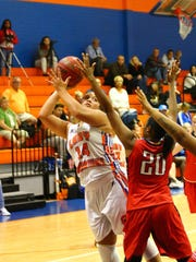 Cape Coral's Faith White goes up for a shot during the Seahawks' Region 7A quarterfinal game with Northeast on Thursday.