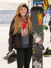 Shasta High's Sage Will poses with her second-place medal in the giant slalom junior women event at the USASA Snowboard Nationals at Copper Mountain, Colorado.