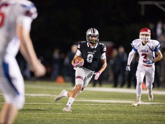 Ankeny Centennial High School's Jake Pinegar (8) runs