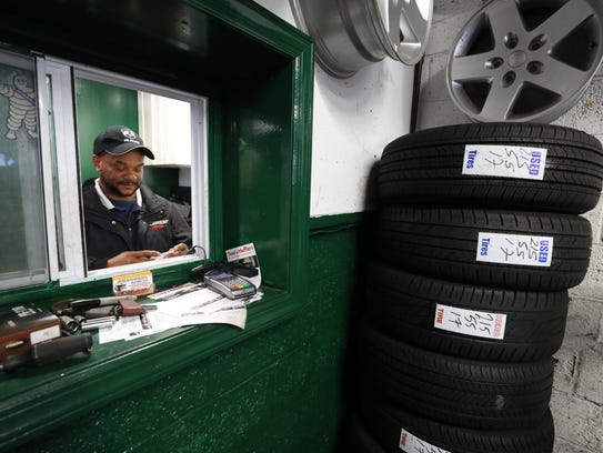 Jose Heredia, an immigrant, runs Hero Tires in Wallington.