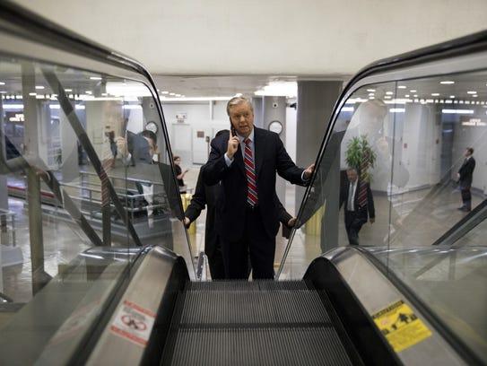 Sen. Lindsey Graham walks to the Senate floor on May