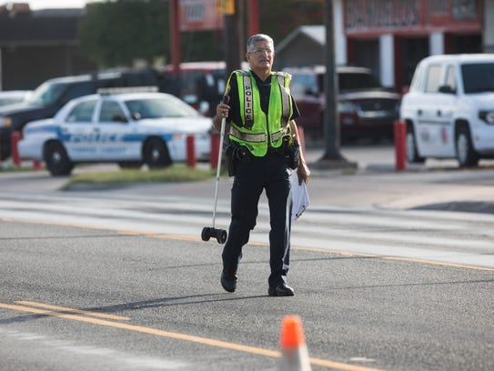 Corpus Christi police officers investigate a hit-and-run