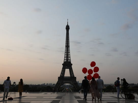 People visit the Trocadero Plaza to take souvenir pictures