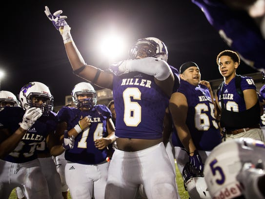 Miller's Khaliq Nickels dances sounded by his teammates