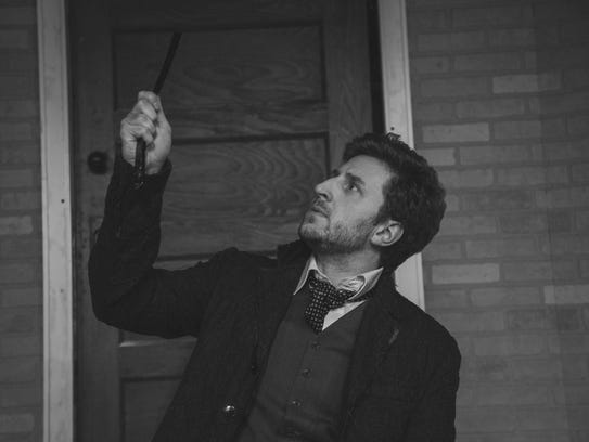 Sweeney Todd, played by Michael Wright of Vernon, seeks