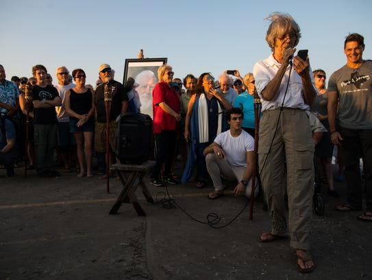 Lynn Amos speaks during a public memorial for her husband