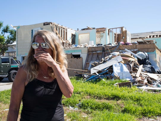 Michele Green stands outside her company destroyed