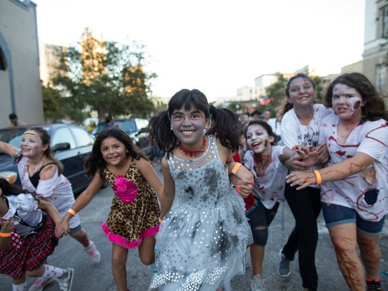 The walking dead took to the streets of downtown Corpus Christi on Saturday during House of Rock's annual Zombie Walk.