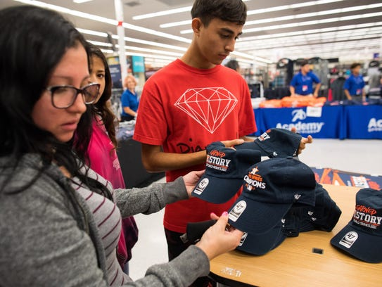 Fans buy Astros World Series Champions gear at Academy Sports and Outdoors in Corpus Christi after the team's Game 7 win over the Los Angeles Dodgers on Wednesday, Nov. 1, 2017.