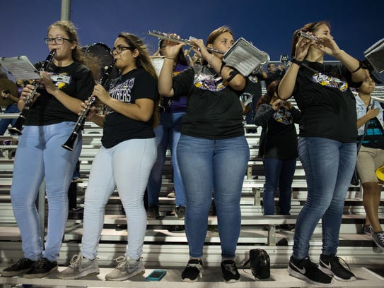 The Aransas Pass marching band plays the national anthem