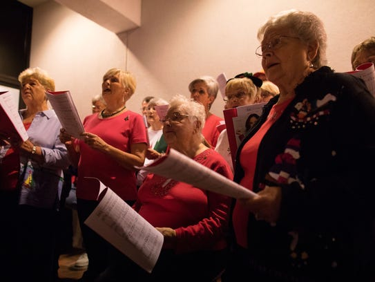 The First Baptist Church of Rockport Choir performs during the Lamar Park Shopping Center annual Lighting of the Park event on Tuesday, Nov. 28, 2017.