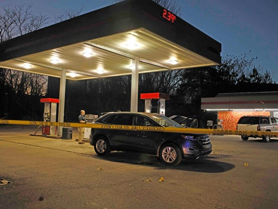A man was shot to death in the parking lot of the In