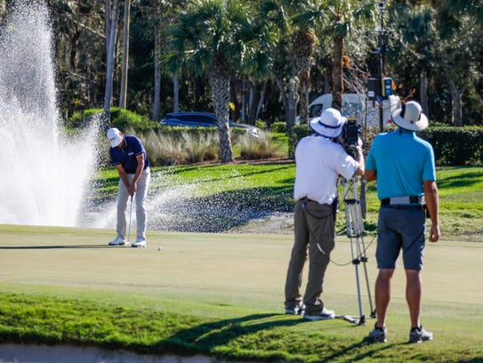The golf channel films while Steve Stricker takes a putt at the Chubb Classic at the Twin Eagles golf course in Naples, Fla. on Saturday, February 17, 2018.