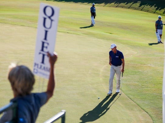 Silence on the 18th green as Steve Stricker examines his line for the final putt at the Chubb Classic at the Twin Eagles golf course in Naples, Fla. on Saturday, February 17, 2018.