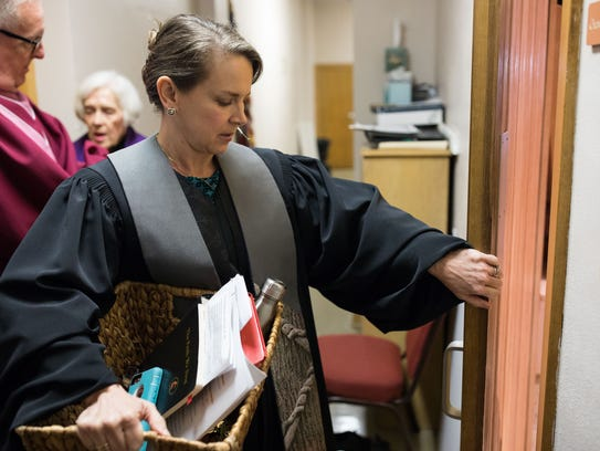 Pamela Dykehouse pastor of the First United Methodist Church in Corpus Christ steps out in to the sanctuary before service on Feb. 25.